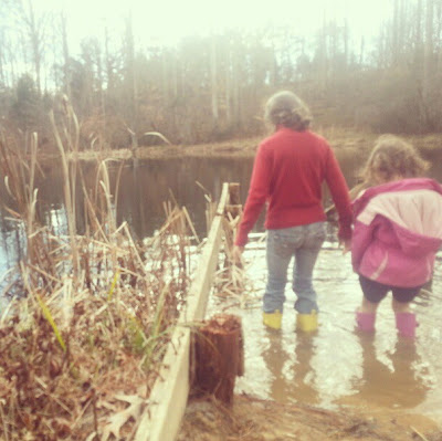 playing in a pond with kids